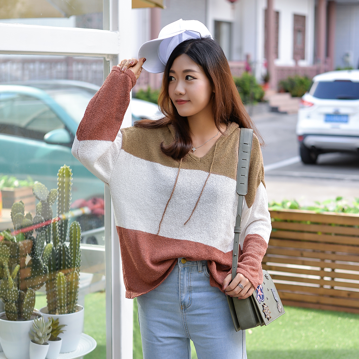 Autumn and winter new lazy style color matching striped sweater womens short hooded loose long sleeved sweater versatile student