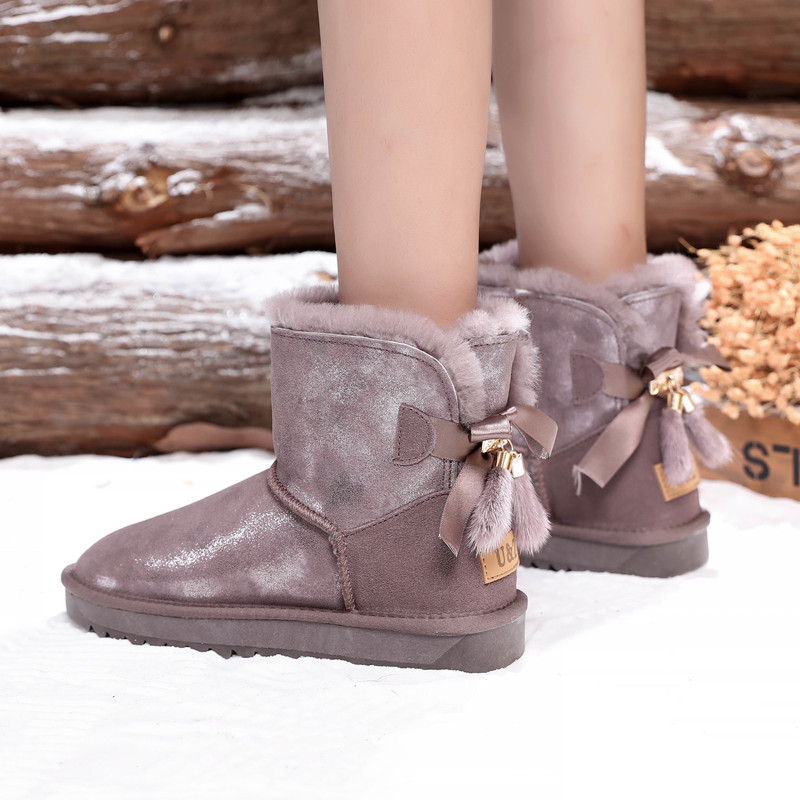 New type of cowhide winter sheep fur integrated middle tube snow boots womens mink hair bow anti slip warm boots cotton shoes