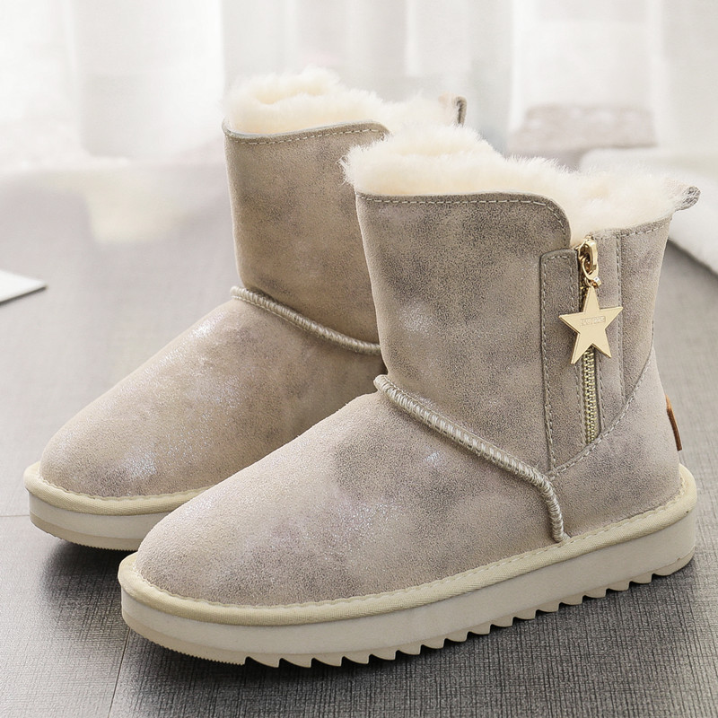 New snow boots womens winter sheep fur integrated middle tube zipper versatile leather waterproof thickening anti slip warm cotton shoes