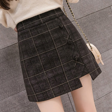 A-shaped winter skirt with high waist and slim skirt decorated with women's buttons in the new Korean version of 100-tie woolen Plaid half-length skirt
