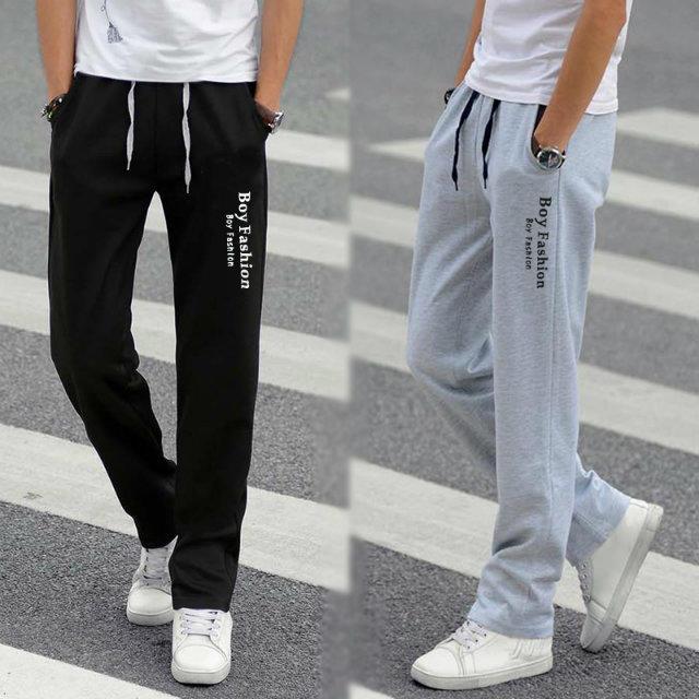 春の夏のスポーツズボンの男性のズボンの薄い金の青少年のゆったりしているまっすぐな筒の潮流の大きいサイズの学生のカジュアルなズボンの男性の衛ズボン