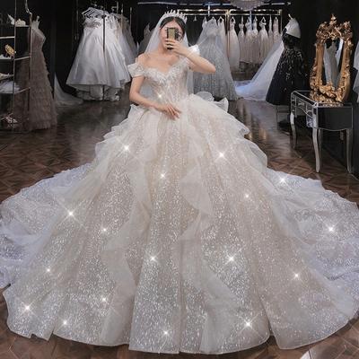 星空主婚纱2021新款新娘气质一字肩法式奢华大拖尾遮粗手臂出门轻