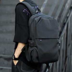 潮流双肩包男士休闲防水旅行包电脑包背包高中初中大学生书包男包