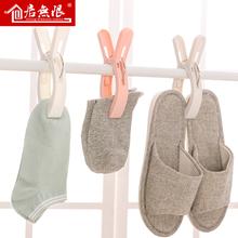 固定家庭靴下防風洗濯ばさみクリップ天日乾燥小さなクリップがプラスチック製のラックをクランプされている