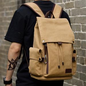 新款帆布男士潮流双肩包大容量中学生书包休闲旅行背包电脑包男包