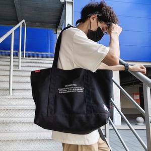 日系工装风潮牌男单肩斜挎包女韩版帆布休闲购物袋手提包大容量