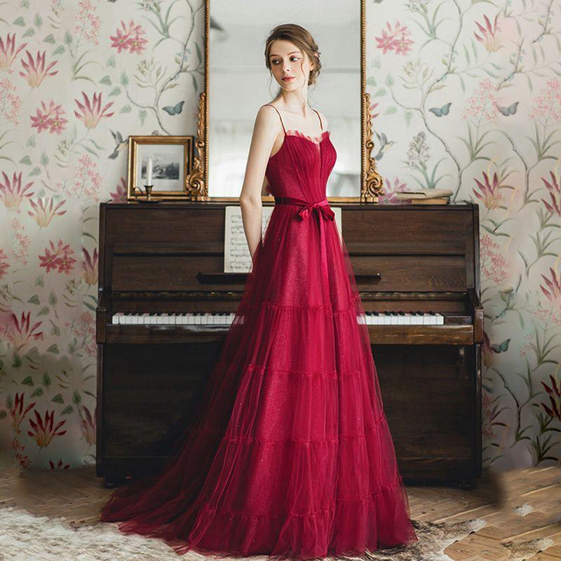 ドレスのワンピースの女性用赤のワイン服の新婦の新型の夏のサスペンダーは明らかにやせている名媛真空のタキシードが現れます。
