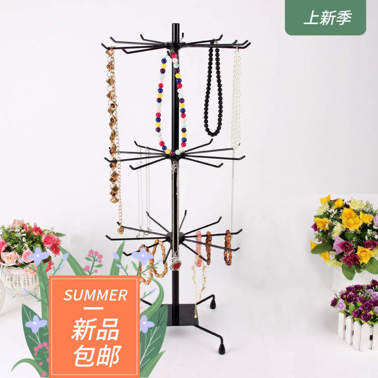 On the new floor display shelf circular rotation multi-layer supermarket iron clothing shop jewelry earrings practical