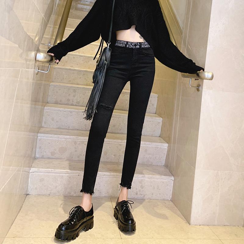 黑色牛仔裤女2020欧货新款秋字母松紧高腰显瘦弹力破洞九分小脚裤
