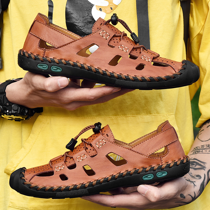 Sandals mens new summer 2020 breathable leather bag head hole tide soft bottom anti slip beach shoes casual large size