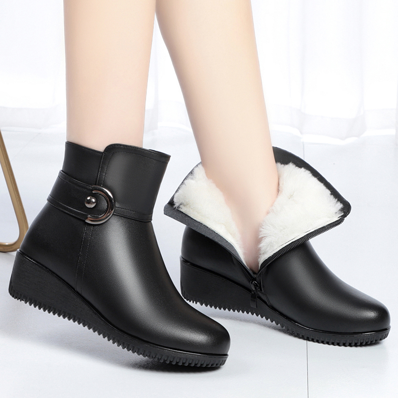 Leather short boots womens 2021 winter new slope heel soft bottom Plush warm wool boots middle-aged and elderly mothers cotton shoes