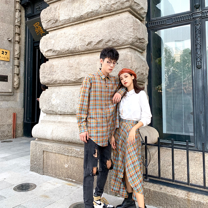 Zhang Zhang singing skirt womens fall 2019 new fashion high waist irregular Plaid mid length skirt
