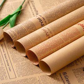 花艺包装纸鲜花礼品牛皮纸干花束材料拍照背景包书皮复古英文报纸图片