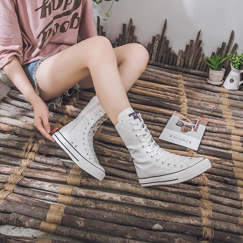 新型の春秋中筒キャンバス靴ファッション女性のチェーン板のファスナーのキャンバス靴は超高くてレジャー靴の男性の大きいサイズの潮流を手伝います。