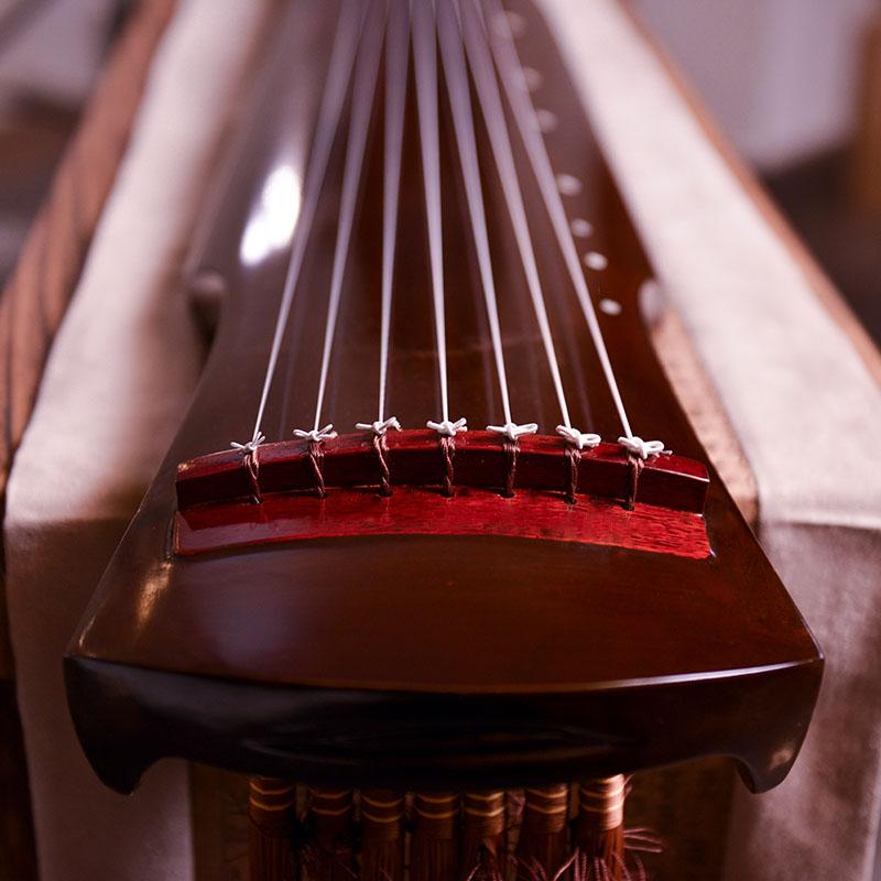 規格品の名の美老桐の木の伏羲式の仲尼の古琴の初学の試験級は7弦の琴の純粋な手の漆の古琴を演奏します