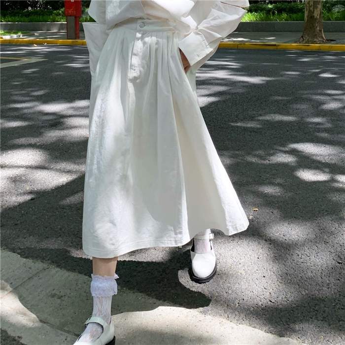 New Korean light cooked meat covered white A-line skirt for women in autumn 2020