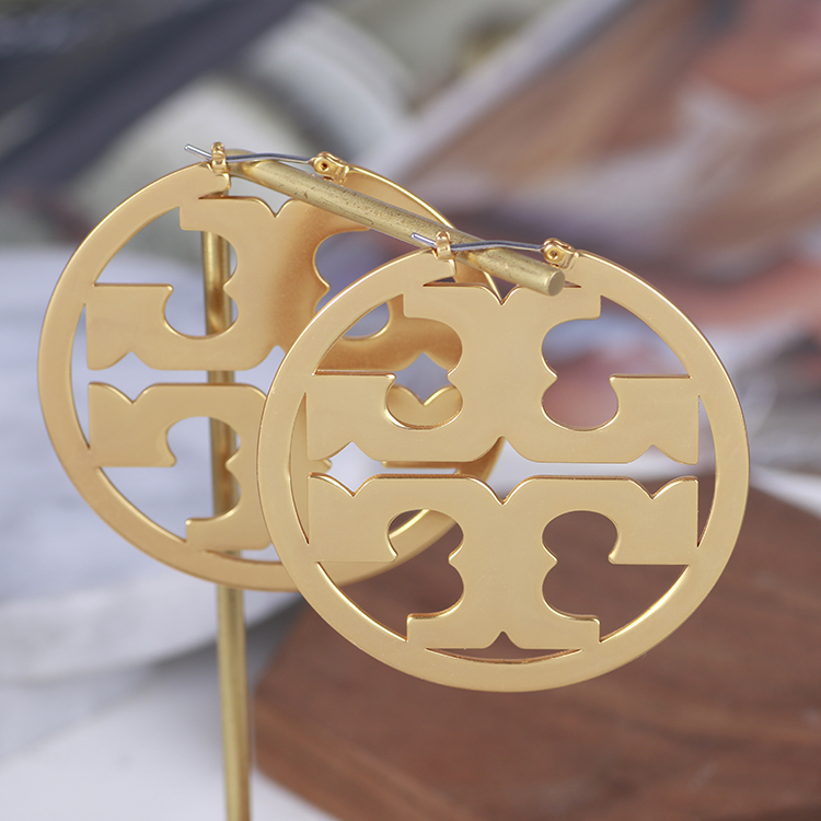 Tory burch Earrings Tori Burch Vintage hollowed out simple fashion style personalized TB Earrings