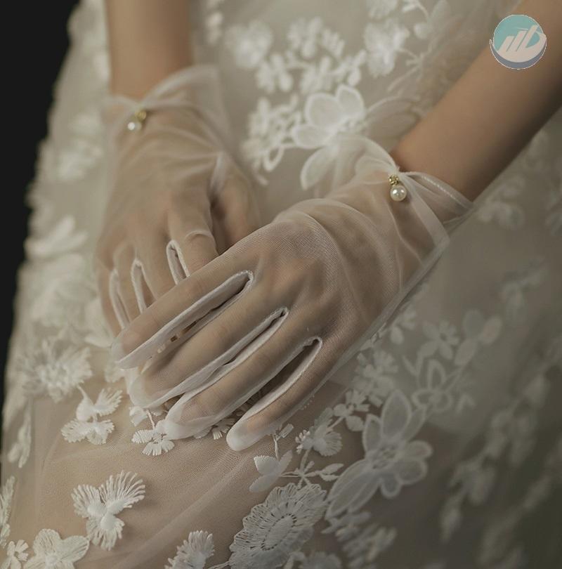 Wedding Gloves and wedding dress in winter
