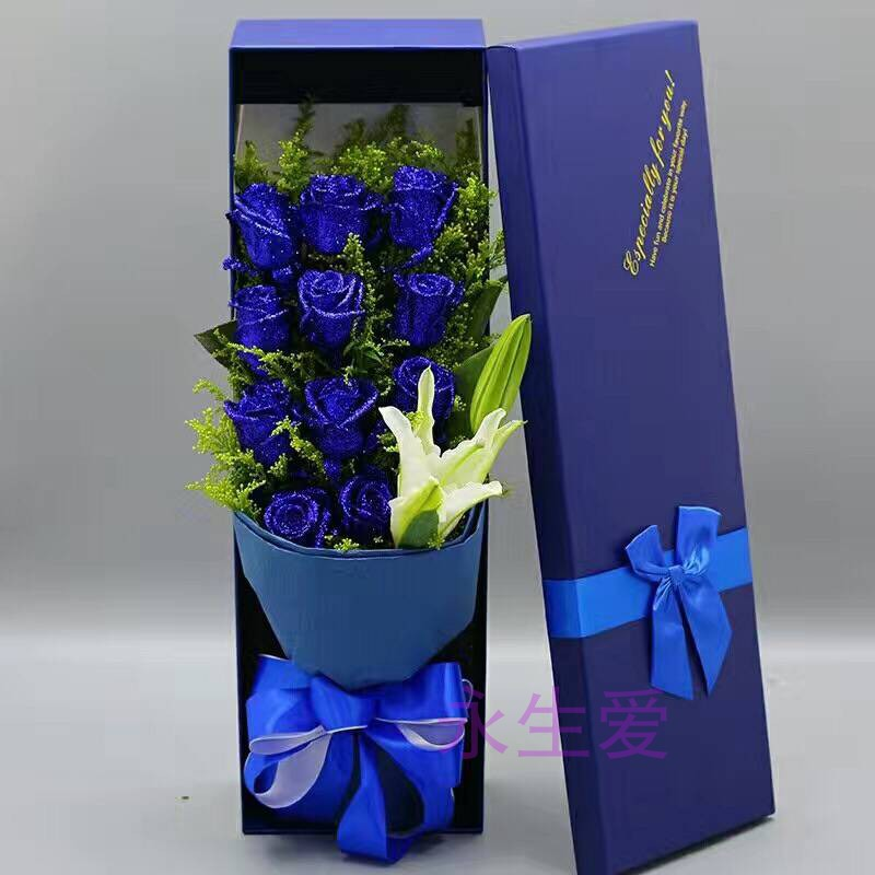 11 blue enchantresses and 1 White Multi headed Lily gift box for Valentines Day