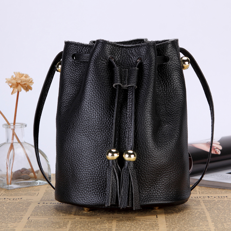 Leather bag womens 2021 new head leather Bucket Bag Mini tassel versatile pure leather One Shoulder Messenger spring and summer