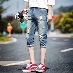领2元券购买夏季薄款男牛仔七分破洞短裤男士修身七分裤宽松休闲五分韩版潮流