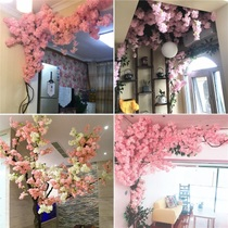 Simulation large cherry tree indoor living room air conditioning pipe ceiling net red shop wall decoration floor plastic fake flower rattan