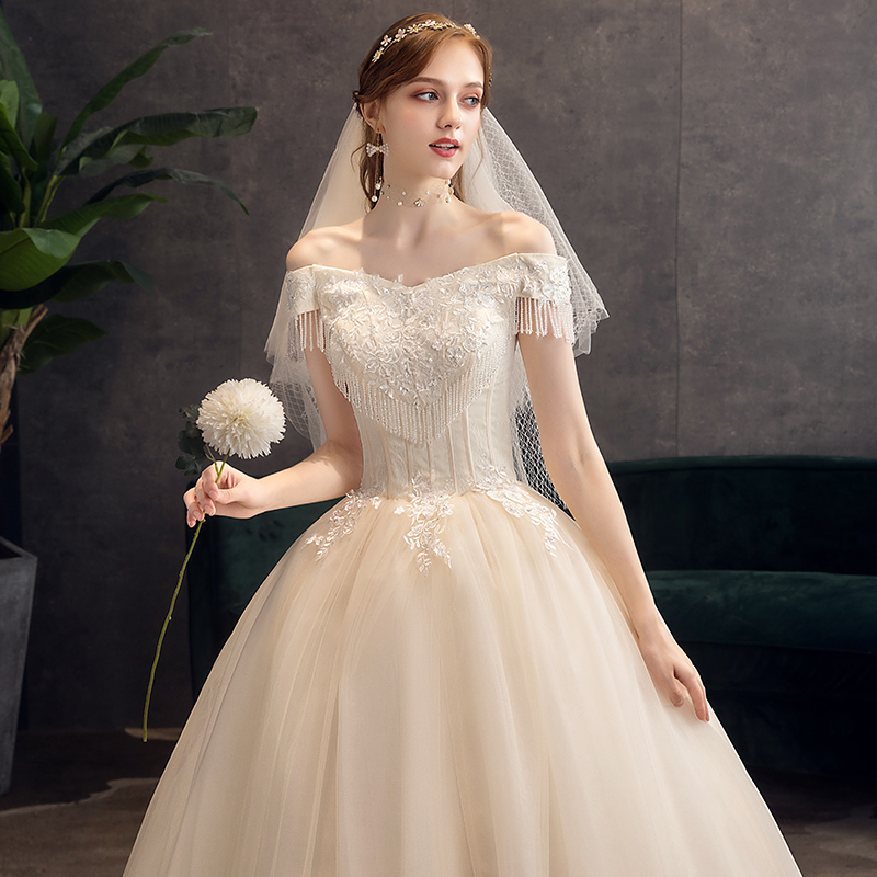 一字肩婚纱礼服2020新款新娘香槟色齐地简约公主梦幻超仙法式森系图片