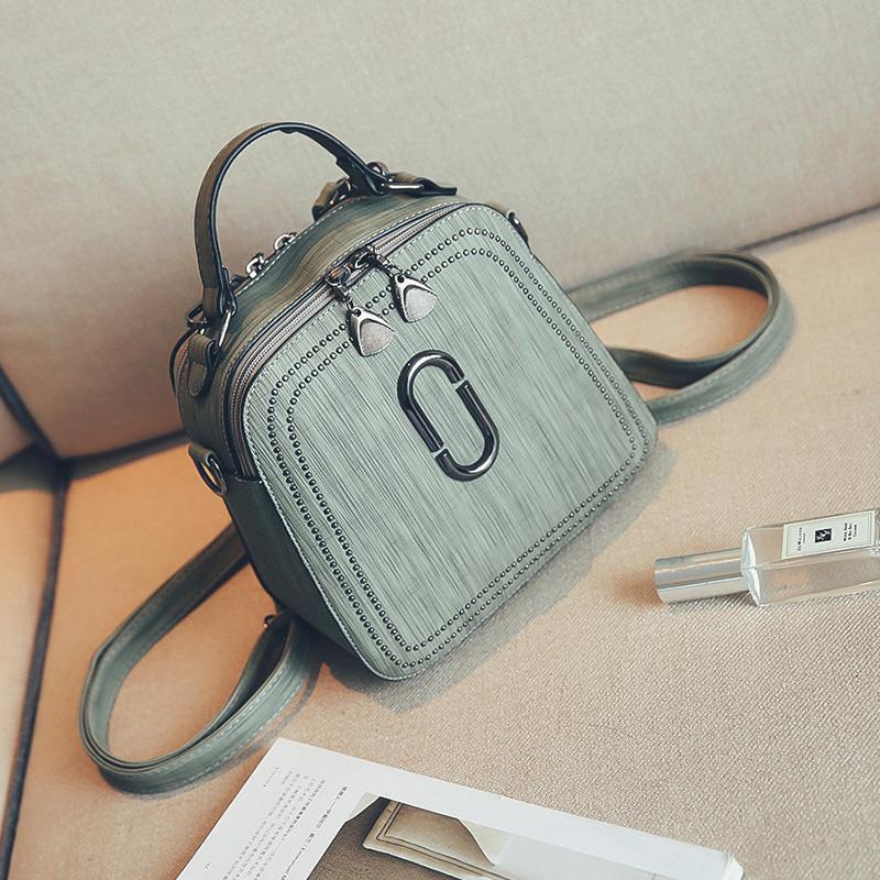 Womens bag 2020 spring and summer new rivet single shoulder double shoulder multi-purpose backpack retro fashion commuter womens handbag