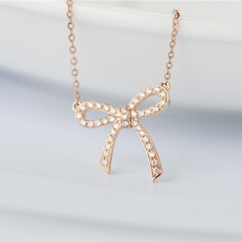 18k золото бант ожерелье из розового золота подвески женщина бриллиантов алмаз ожерелье женщина мой назад половина сырье в этом же моделье