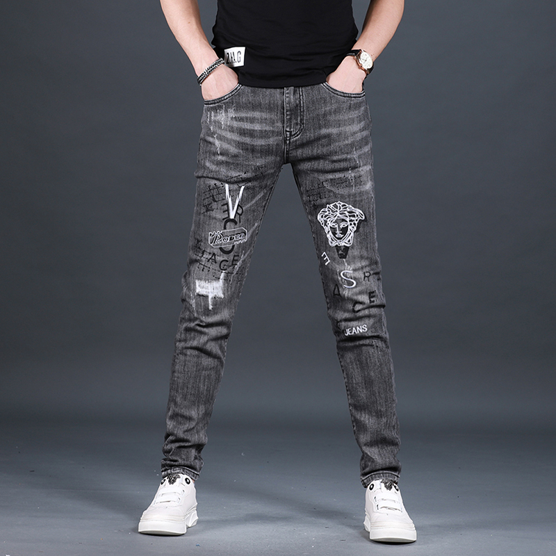 High end mens perforated embroidered printed jeans mens Korean fashion brand slim legged pants in summer