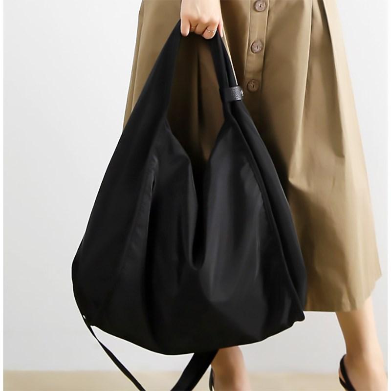 だるくて怠惰な風の大きい包みの新型のカジュアルな百合牛津布大容量の女性の包みの文芸范帆の布の包みの単に肩の斜めなショルダーバッグ