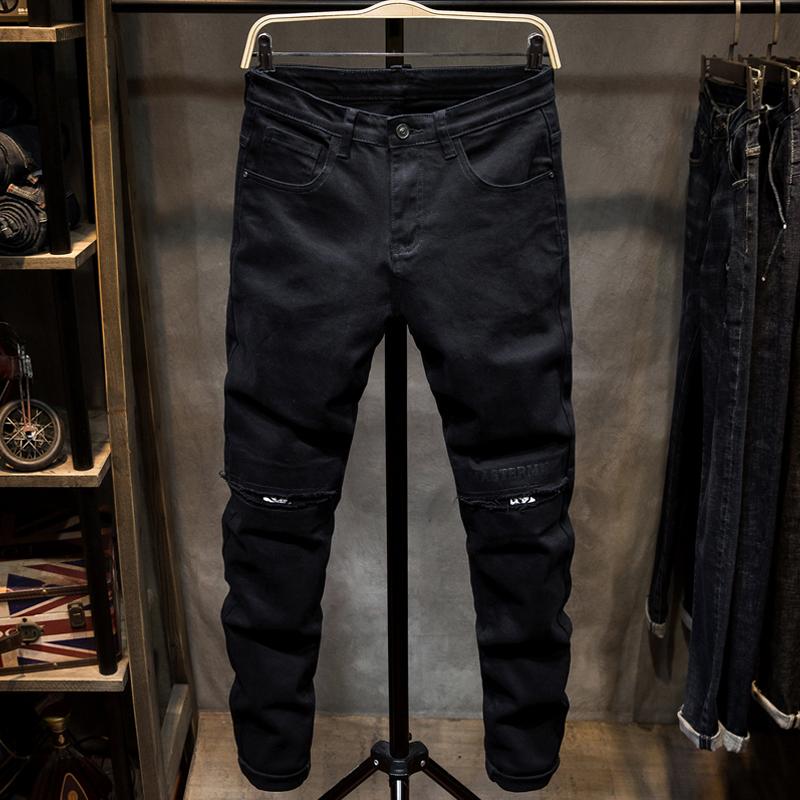 热销20件不包邮秋冬纯黑色修身小脚弹力街头牛仔裤