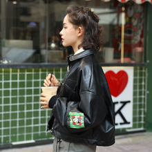 Alike Unlike! Handsome and super soft black PU leather jacket printed in Hong Kong style, spring and autumn short jacket for women