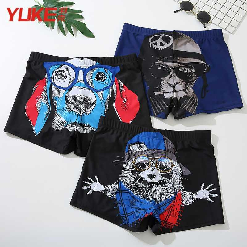 Swimming trunks mens flat angle anti embarrassment mens fashionable swimming trunks loose and coquettish swimsuit mens sexy fashion brand swimming equipment