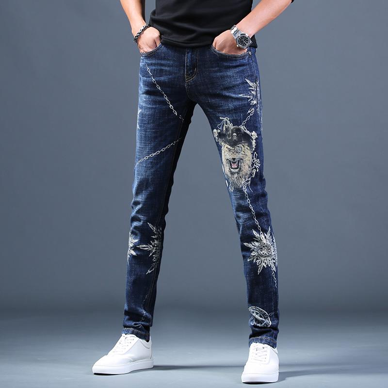 男士印花破洞牛仔褲男高端休閑長褲子2020新款春季韓版潮流小腳褲