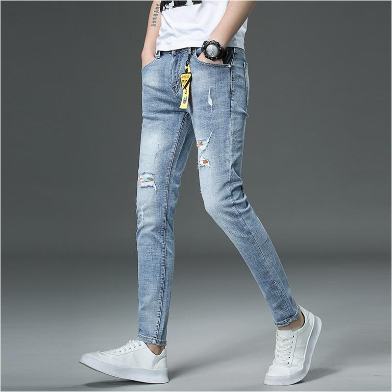 香港高端男士破洞补丁浅蓝色牛仔裤限1000张券
