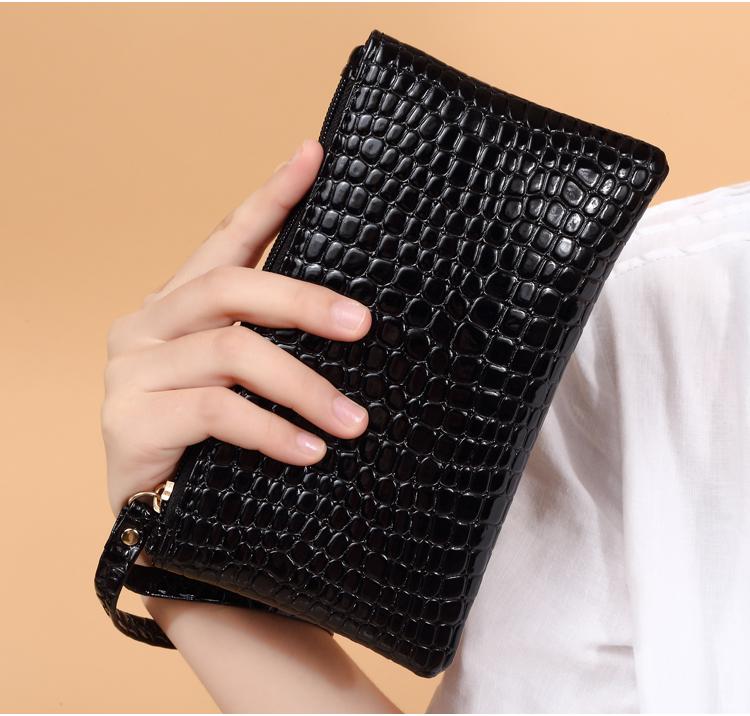 简约手拿包女包拉链手机包零钱包小包包迷你手抓包韩版潮一件包邮