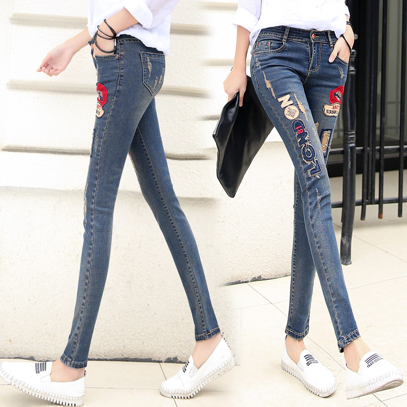 Spring 2020 new embroidered pencil long pants with holes in the middle waist and small leg jeans for womens slim fit