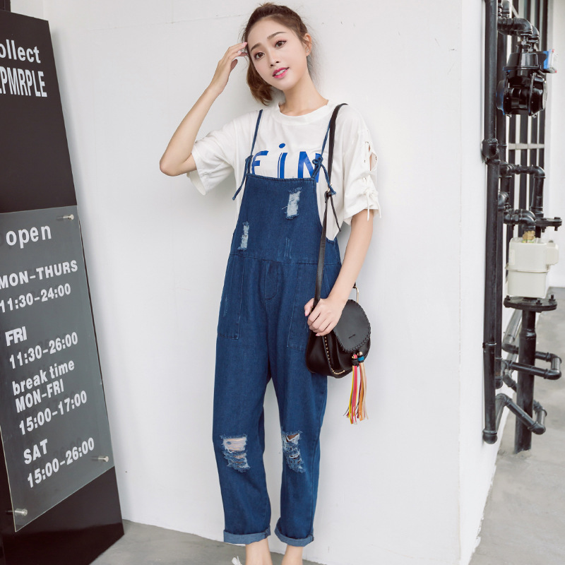 New spring and summer clothes are versatile, loose young womens broken hole suspender pants fat mm suspender jeans Jumpsuit Korean version