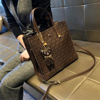香港品牌真皮包包2021新款高级复古斜跨女包质感洋气大容量水桶包