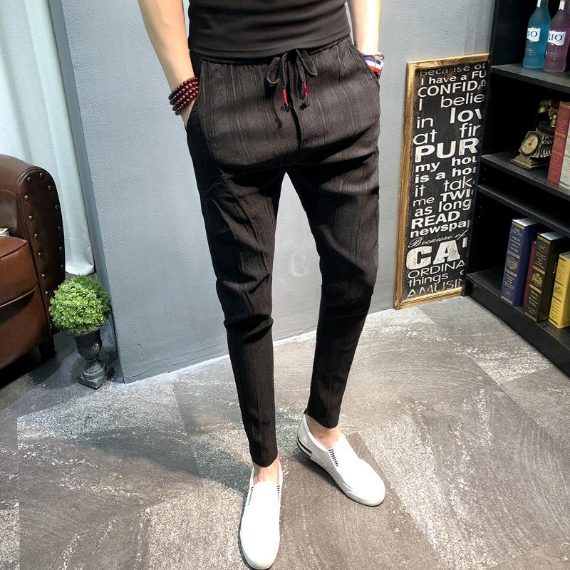 春夏男士潮流韩版修身小脚条纹裤子