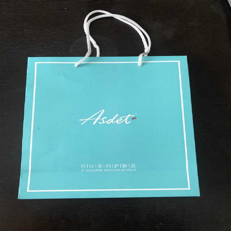 Бумажные пакеты товар в наличии Сумка для переноски оптовые продажи Специальная подарочная сумка для косметической печати 250 * 100 * 280 мм