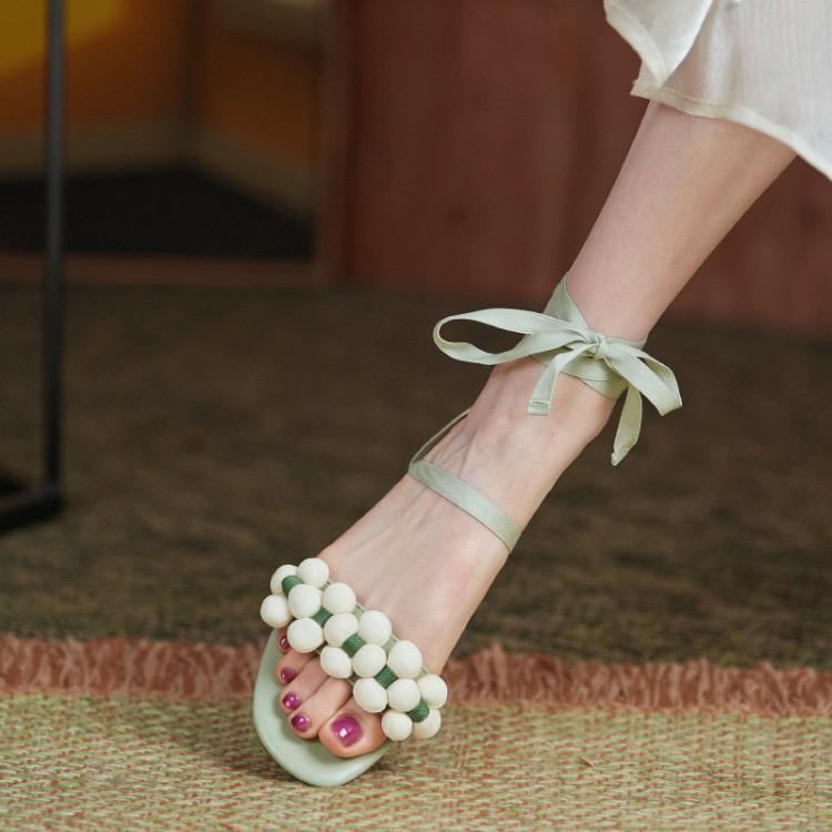 仙女风系带凉鞋女时尚牛皮花朵脚踝绊带露趾平底时装沙滩鞋拖鞋
