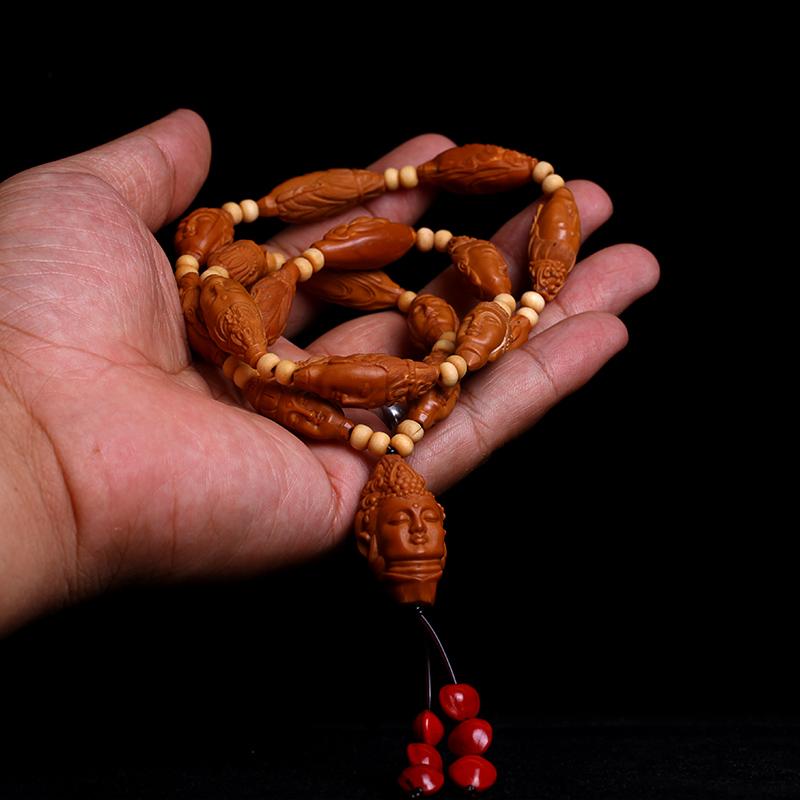 Разные сувениры из косточек фруктов Артикул 599737378418