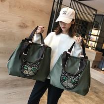 拉杆旅行包旅行袋手提大容量登机飞机行李包滑轮买菜旅游轻便包女