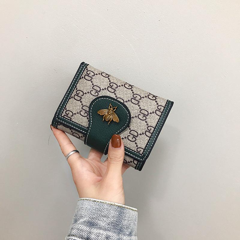 2020新款女士钱包女短款ins潮多卡位三折叠撞色搭扣手拿包小钱夹图片