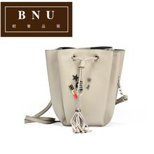 BNU light luxury European and American badge Bucket Bag New Lady retro genuine leather bag with solid color messenger bag qq707