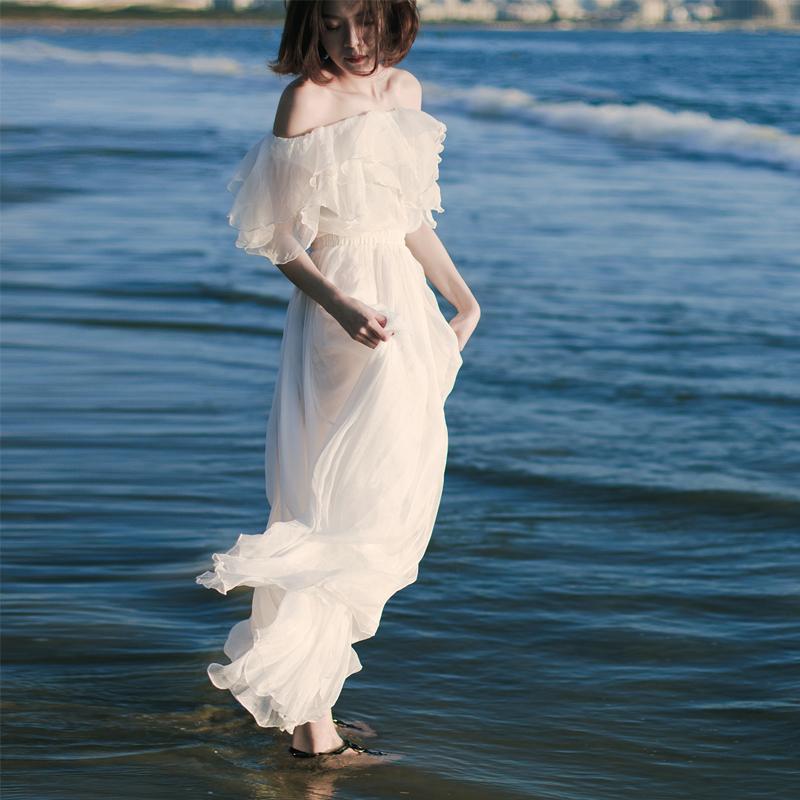 奈良白色三亚沙滩裙女显瘦长裙雪纺海边度假一字肩连衣裙超仙长款图片