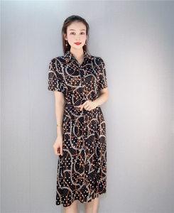 2021年夏季专柜撤柜时尚印花几何修身短袖衬衫领开扣中长款连衣裙