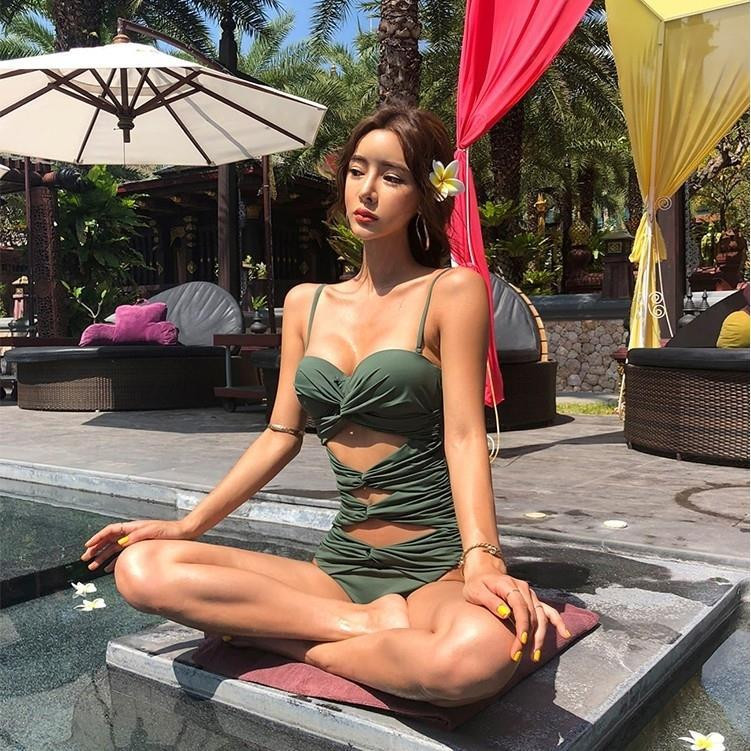 Hot selling hollow sling hot spring bikini one-piece small chest steel bracket gathered slim open back swimsuit female sexy